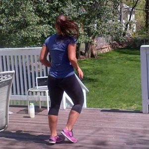 Woman on her back porch working out
