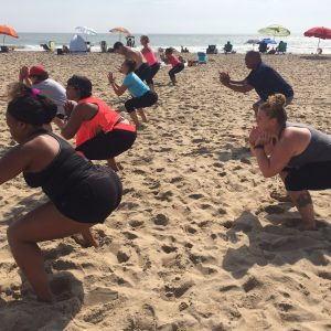 Squats on oceanfront with group
