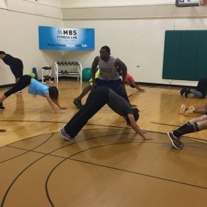 Core exercises while getting coached in gym