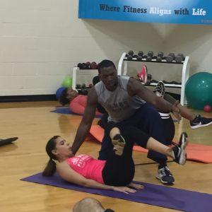 Monte Sanders instructing how to do leg exercises