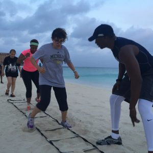 Fancy footwork on the beach with fitness trainer