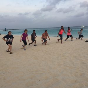 Lunges with corporate friends on beach