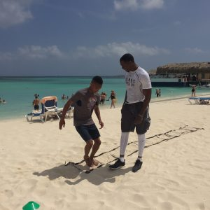 Sides steps on beach with Celebrity Fitness Trainer