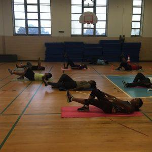 Doing group leg lifts