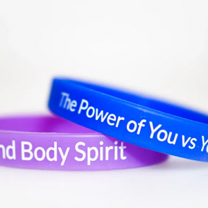 Image of Purple and Blue armbands with wording on them
